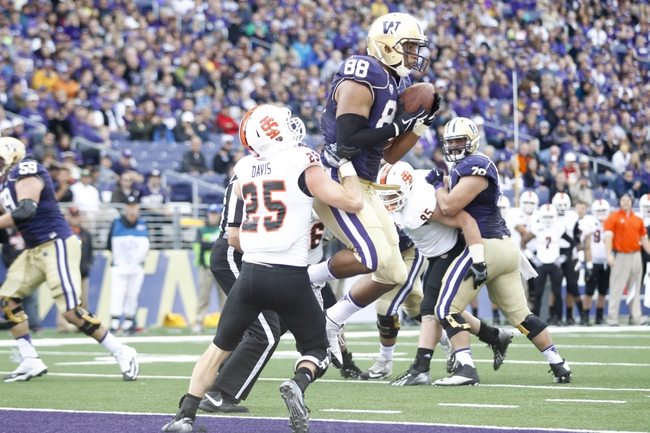 Sep 21, 2013; Seattle, WA, USA; Washington Huskies tight end Austin Seferian-Jenkins (88) makes a touchdown reception against the Idaho State Bengals during the first quarter at Husky Stadium. Mandatory Credit: Joe Nicholson-USA TODAY Sports
