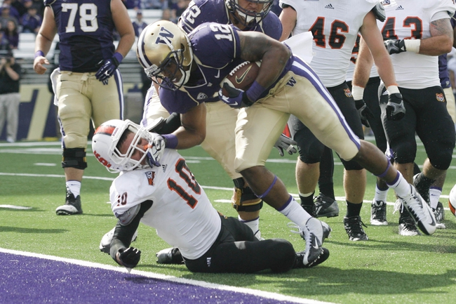 Sep 21, 2013; Seattle, WA, USA; Washington Huskies running back Dwayne Washington (12) rushes for a touchdown against Idaho State Bengals safety Taison Manu (10) during the second quarter at Husky Stadium. Mandatory Credit: Joe Nicholson-USA TODAY Sports