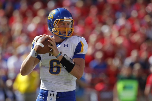 Sep 21, 2013; Lincoln, NE, USA; South Dakota State Jackrabbits quarterback Austin Sumner (6) looks to pass against the Nebraska Cornhuskers in the first quarter at Memorial Stadium. Mandatory Credit: Bruce Thorson-USA TODAY Sports