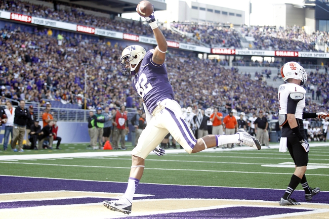 Sep 21, 2013; Seattle, WA, USA; Washington Huskies tight end Joshua Perkins (82) makes a touchdown reception against the Idaho State Bengals during the second quarter at Husky Stadium. Mandatory Credit: Joe Nicholson-USA TODAY Sports