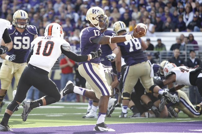 Sep 21, 2013; Seattle, WA, USA; Washington Huskies quarterback Keith Price (17) rushes for a touchdown against the Idaho State Bengals during the first quarter at Husky Stadium. Mandatory Credit: Joe Nicholson-USA TODAY Sports