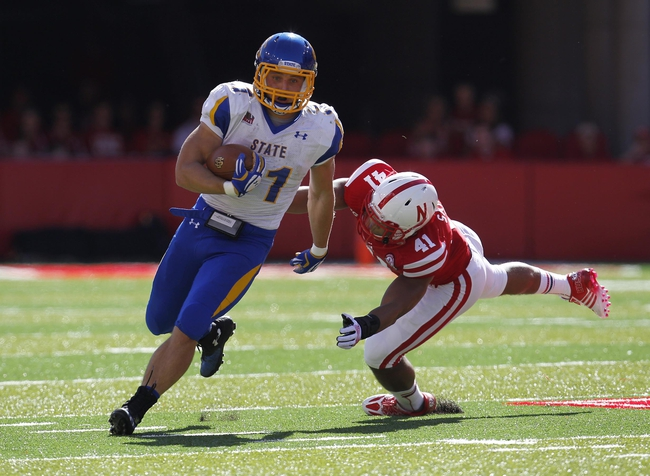 Sep 21, 2013; Lincoln, NE, USA; South Dakota State Jackrabbits running back Zach Zenner (31) runs away from Nebraska Cornhuskers defender David Santos (41) in the first quarter at Memorial Stadium. Mandatory Credit: Bruce Thorson-USA TODAY Sports