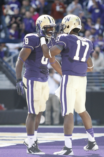 Sep 21, 2013; Seattle, WA, USA; Washington Huskies wide receiver Kevin Smith (8) celebrates with Washington Huskies quarterback Keith Price (17) after Price rushed for a touchdown against the Idaho State Bengals during the first quarter at Husky Stadium. Mandatory Credit: Joe Nicholson-USA TODAY Sports