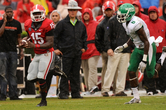Sep 21, 2013; Athens, GA, USA; Georgia Bulldogs running back J.J. Green (15) runs past North Texas Mean Green defensive back Hilbert Jackson (6) during the second half at Sanford Stadium. Georgia defeated North Texas 45-21. Mandatory Credit: Dale Zanine-USA TODAY Sports