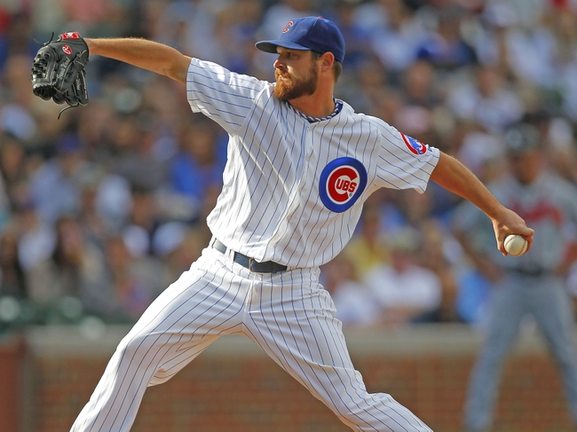 Sep 21, 2013; Chicago, IL, USA; Chicago Cubs starting pitcher Travis Wood (37) throws a pitch in the third inning against the Atlanta Braves at Wrigley Field. Mandatory Credit: Dennis Wierzbicki-USA TODAY Sports