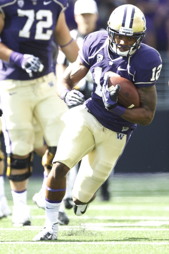 Sep 21, 2013; Seattle, WA, USA; Washington Huskies running back Dwayne Washington (12) rushes against the Idaho State Bengals during the second quarter at Husky Stadium. Mandatory Credit: Joe Nicholson-USA TODAY Sports