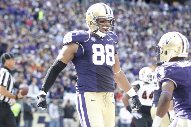 Sep 21, 2013; Seattle, WA, USA; Washington Huskies tight end Austin Seferian-Jenkins (88) celebrates after catching a touchdown pass against the Idaho State Bengals during the second quarter at Husky Stadium. Mandatory Credit: Joe Nicholson-USA TODAY Sports