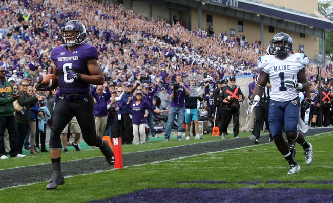 Sep 21, 2013; Evanston, IL, USA; Northwestern Wildcats wide receiver Tony Jones (6) scores a touchdown past Maine Black Bears defensive back Axel Ofori (1) during the first quarter at Ryan Field.  Mandatory Credit: Jerry Lai-USA TODAY Sports