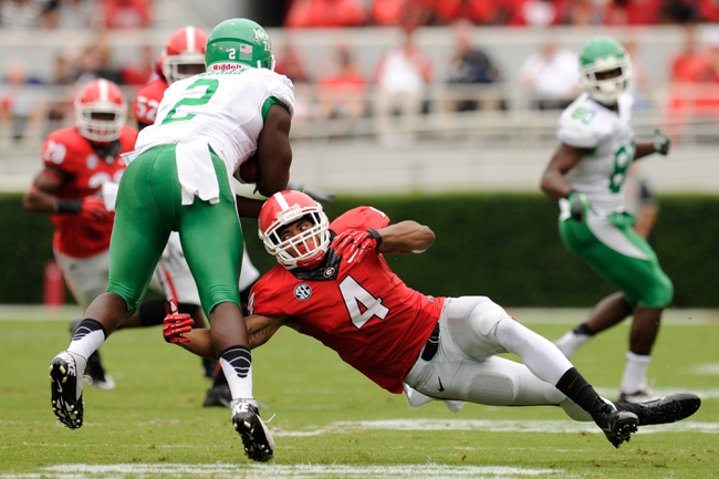 Sep 21, 2013; Athens, GA, USA; Georgia Bulldogs cornerback Brendan Langley (4) tackles North Texas Mean Green running back Reggie Pegram (2) during the first half at Sanford Stadium. Georgia defeated North Texas 45-21. Mandatory Credit: Dale Zanine-USA TODAY Sports