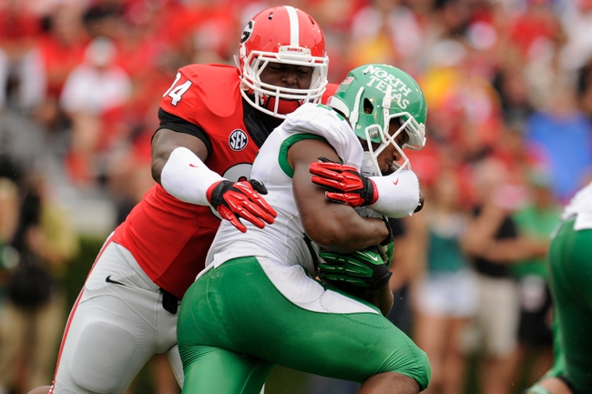 Sep 21, 2013; Athens, GA, USA; Georgia Bulldogs defensive end John Taylor (94) tackles North Texas Mean Green running back Brandin Byrd (24) during the first half at Sanford Stadium. Georgia defeated North Texas 45-21. Mandatory Credit: Dale Zanine-USA TODAY Sports