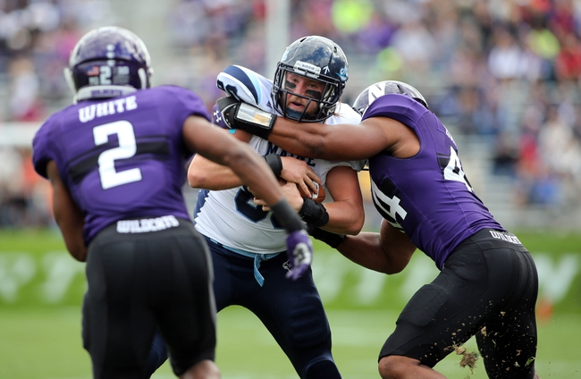 Sep 21, 2013; Evanston, IL, USA; Maine Black Bears tight end Justin Perillo (80) is tackled by Northwestern Wildcats linebacker Chi Chi Ariguzo (44) and cornerback Dwight White (2) during the first quarter at Ryan Field.  Mandatory Credit: Jerry Lai-USA TODAY Sports