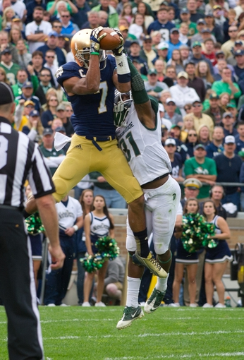 Sep 21, 2013; South Bend, IN, USA; Notre Dame Fighting Irish wide receiver TJ Jones (7) catches a touchdown pass as Michigan State Spartans cornerback Darqueze Dennard (31) defends in the second quarter at Notre Dame Stadium. Mandatory Credit: Matt Cashore-USA TODAY Sports