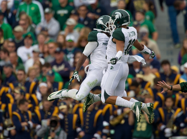 Sep 21, 2013; South Bend, IN, USA; Michigan State Spartans wide receiver Macgarrett Kings (3) celebrates with running back R.J. Shelton (12) after scoring a touchdown in the second quarter against the Notre Dame Fighting Irish at Notre Dame Stadium. Mandatory Credit: Matt Cashore-USA TODAY Sports