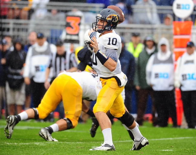 Sep 21, 2013; University Park, PA, USA; Kent State Golden Flashes quarterback Colin Reardon (10) throws a pass in the second quarter against the Penn State Nittany Lions at Beaver Stadium. Mandatory Credit: Evan Habeeb-USA TODAY Sports