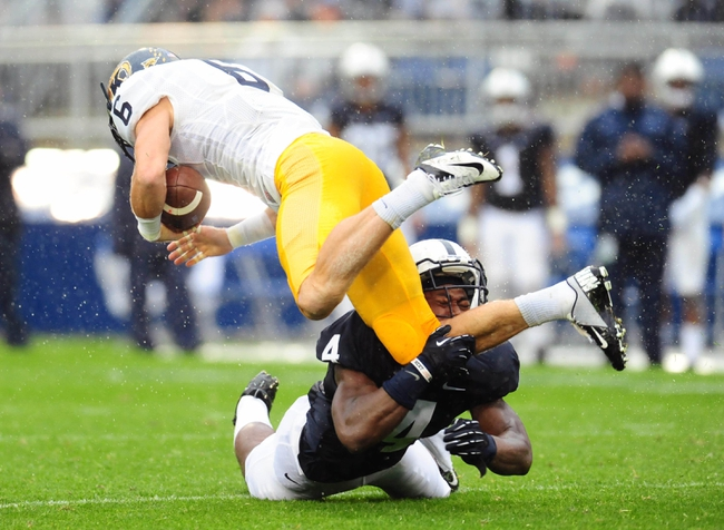 Sep 21, 2013; University Park, PA, USA; Kent State Golden Flashes wide receiver Chris Humphrey (6) gets tackled by Penn State Nittany Lions safety Adrian Amos (4) at Beaver Stadium. Mandatory Credit: Evan Habeeb-USA TODAY Sports