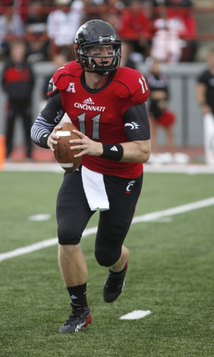 Sep 21, 2013; Oxford, OH, USA; Cincinnati Bearcats quarterback Brendon Kay (11) looks to throw against the Miami (Oh) Redhawks  at Fred Yager Stadium. Mandatory Credit: David Kohl-USA TODAY Sports