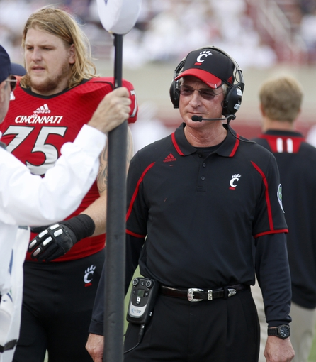 Sep 21, 2013; Oxford, OH, USA; Cincinnati Bearcats head coach Tommy Tuberville walks down the sideline in the first quarter during a game against the Miami (Oh) Redhawks at Fred Yager Stadium. Mandatory Credit: David Kohl-USA TODAY Sports