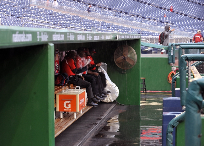 Sep 21, 2013; Washington, DC, USA; General view of employees in the dugout during rain delay prior to a game between the Miami Marlins and the Washington Nationals at Nationals Park. Mandatory Credit: Joy R. Absalon-USA TODAY Sports