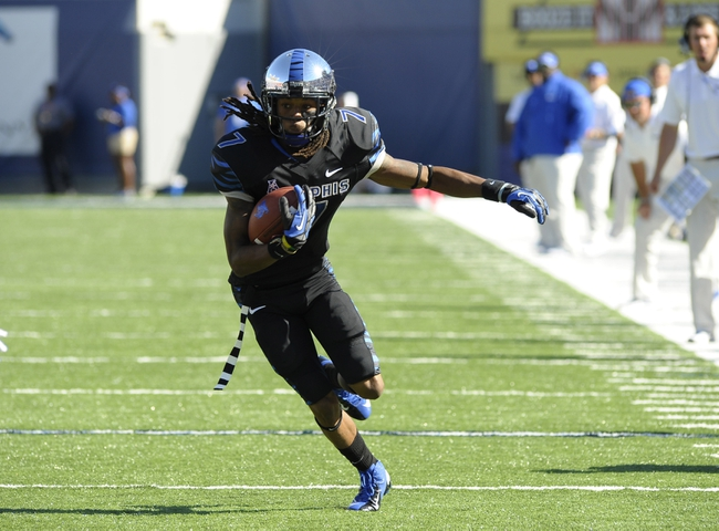 Sep 21, 2013; Memphis, TN, USA; Memphis Tigers wide receiver Keiwone Malone (7) carries the ball at Liberty Bowl Memorial. Mandatory Credit: Justin Ford-USA TODAY Sports