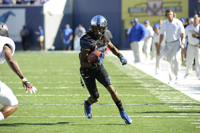 Sep 21, 2013; Memphis, TN, USA;Memphis Tigers wide receiver Keiwone Malone (7) carries the ball at Liberty Bowl Memorial. Mandatory Credit: Justin Ford-USA TODAY Sports