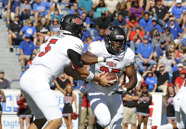 Sep 21, 2013; Memphis, TN, USA; Arkansas State Red Wolves quarterback Adam Kennedy (5) hands the ball off to  Arkansas State Red Wolves running back David Oku (25) at Liberty Bowl Memorial. Mandatory Credit: Justin Ford-USA TODAY Sports