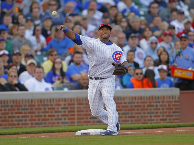 Sep 21, 2013; Chicago, IL, USA; Chicago Cubs third baseman Luis Valbuena (24) steps on third base for a force out and throws to first base to complete a double play in the eighth inning against the Atlanta Braves at Wrigley Field. Mandatory Credit: Dennis Wierzbicki-USA TODAY Sports