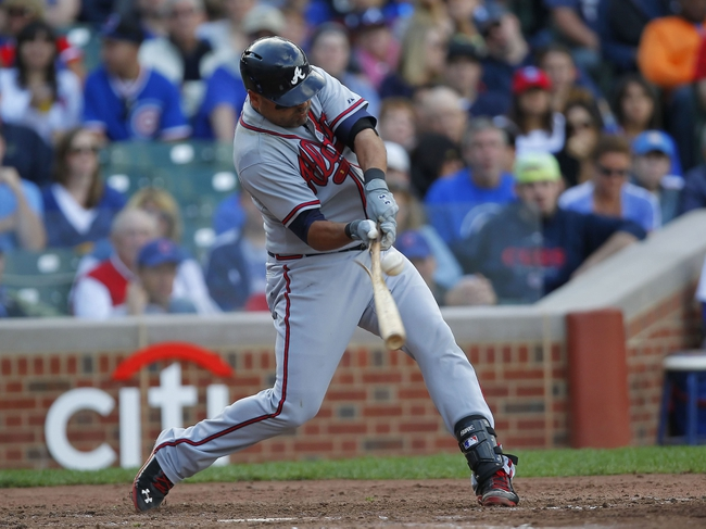 Sep 21, 2013; Chicago, IL, USA; Atlanta Braves player Gerald Laird (11) breaks his bat in the sixth inning against the Chicago Cubs at Wrigley Field. Mandatory Credit: Dennis Wierzbicki-USA TODAY Sports