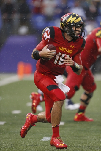 Sep 21, 2013; Baltimore, MD, USA; Maryland Terrapins quarterback CJ Brown (16) runs for yardage against the West Virginia Mountaineers at M&T Bank Stadium. Mandatory Credit: Mitch Stringer-USA TODAY Sports