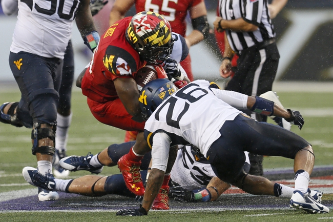 Sep 21, 2013; Baltimore, MD, USA; Maryland Terrapins running back Brandon Ross (45) is tackled following a gain by West Virginia Mountaineers linebacker Tyler Anderson (53) at M&T Bank Stadium. Mandatory Credit: Mitch Stringer-USA TODAY Sports