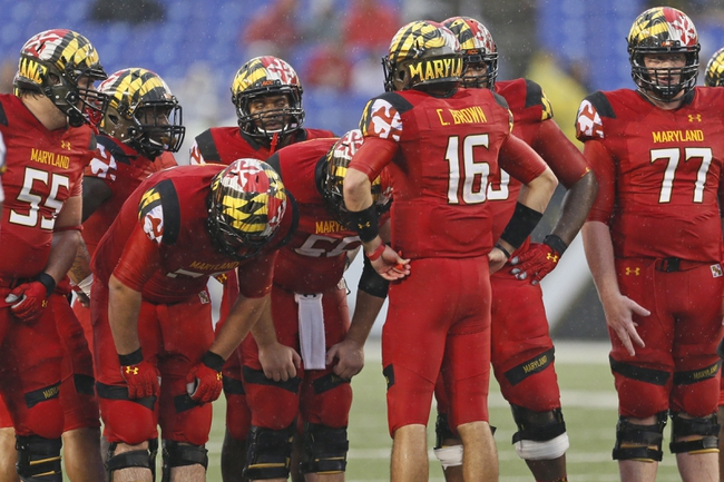 Sep 21, 2013; Baltimore, MD, USA; Maryland Terrapins quarterback CJ Brown (16) leads the offensive huddle durin