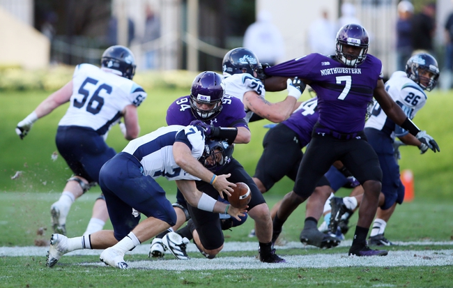 Sep 21, 2013; Evanston, IL, USA; Northwestern Wildcats defensive lineman Dean Lowry (94) forces Maine Black Bears quarterback Marcus Wasilewski (7) to fumble during the fourth quarter at Ryan Field.  Mandatory Credit: Jerry Lai-USA TODAY Sports