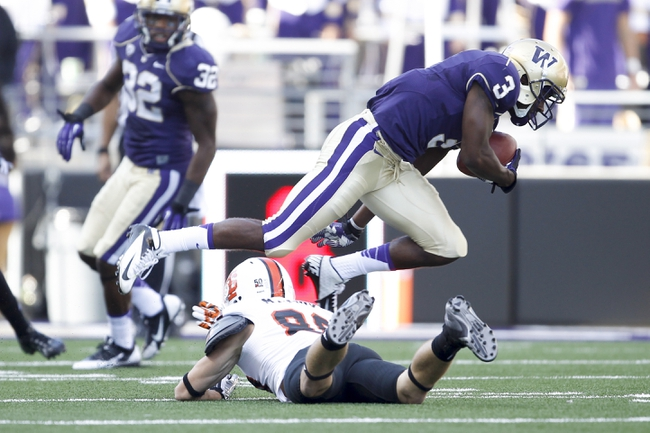 Sep 21, 2013; Seattle, WA, USA; Washington Huskies cornerback Cleveland Wallace (3) intercepts a pass against the Idaho State Bengals during the third quarter at Husky Stadium. Mandatory Credit: Joe Nicholson-USA TODAY Sports