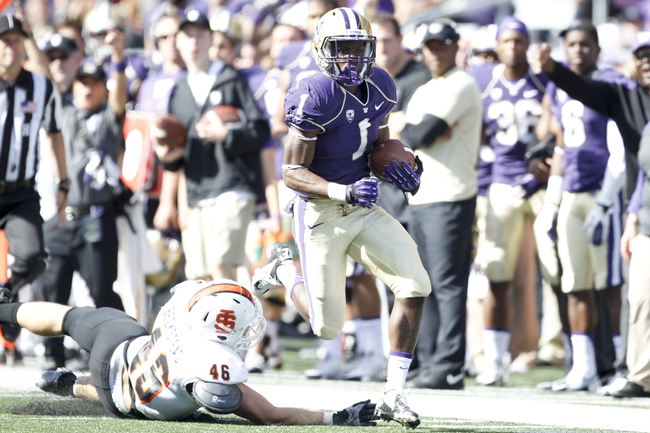 Sep 21, 2013; Seattle, WA, USA; Washington Huskies wide receiver John Ross (1) takes a reception up the sideline for a touchdown against the Idaho State Bengals during the third quarter at Husky Stadium. Mandatory Credit: Joe Nicholson-USA TODAY Sports