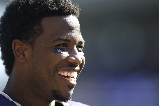 Sep 21, 2013; Seattle, WA, USA; Washington Huskies quarterback Keith Price (17) smiles after his teammates scored a touchdown during the fourth quarter of a 56-0 victory over the Idaho State Bengals at Husky Stadium. Mandatory Credit: Joe Nicholson-USA TODAY Sports