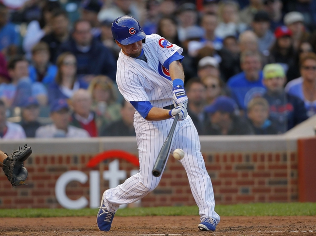 Sep 21, 2013; Chicago, IL, USA; Chicago Cubs third baseman Donnie Murphy (8) hits a single in the eighth inning against the Atlanta Braves at Wrigley Field. Chicago won 3-1. Mandatory Credit: Dennis Wierzbicki-USA TODAY Sports