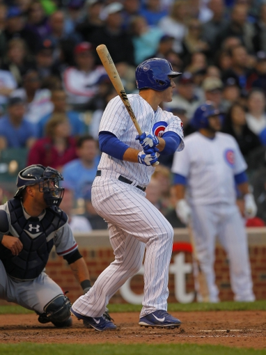 Sep 21, 2013; Chicago, IL, USA; Chicago Cubs first baseman Anthony Rizzo (44) hits an RBI double in the eighth inning against the Atlanta Braves at Wrigley Field. Chicago won 3-1. Mandatory Credit: Dennis Wierzbicki-USA TODAY Sports