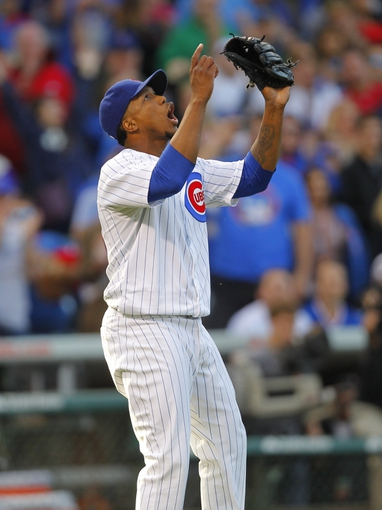 Sep 21, 2013; Chicago, IL, USA; Chicago Cubs relief pitcher Pedro Strop (46) celebrates getting the final out in the ninth inning against the Atlanta Braves at Wrigley Field. Chicago won 3-1. Mandatory Credit: Dennis Wierzbicki-USA TODAY Sports