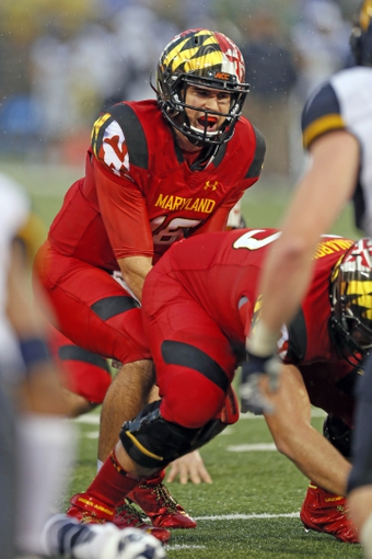 Sep 21, 2013; Baltimore, MD, USA; Maryland Terrapins quarterback CJ Brown (16) leads the offense during the game against the West Virginia Mountaineers at M&T Bank Stadium. Mandatory Credit: Mitch Stringer-USA TODAY Sports