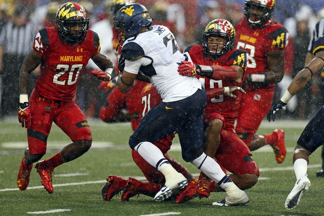 Sep 21, 2013; Baltimore, MD, USA; Maryland Terrapins defense stops Virginia Mountaineers running back Charles Sims (3) at M&T Bank Stadium. Mandatory Credit: Mitch Stringer-USA TODAY Sports