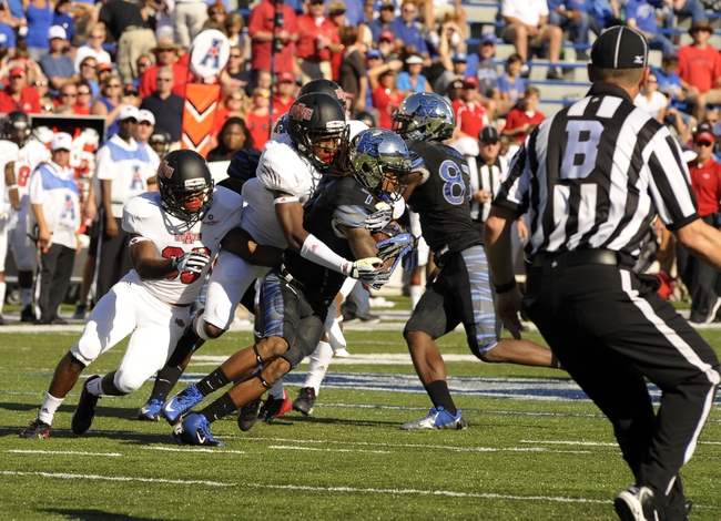 Sep 21, 2013; Memphis, TN, USA; Arkansas State Red Wolves defensive back Sterling Young (11) brings down Memphis Tigers wide receiver Keiwone Malone (7) at Liberty Bowl Memorial. Mandatory Credit: Justin Ford-USA TODAY Sports