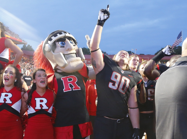 Sep 21, 2013; Piscataway, NJ, USA;  Rutgers Scarlet Knights mascot and defensive end David Milewski (90) celebrate come from behind victory over Arkansas Razorbacks at High Points Solutions Stadium. Rutgers Scarlet Knights defeat the Arkansas Razorbacks 28-24. Mandatory Credit: Jim O'Connor-USA TODAY Sports