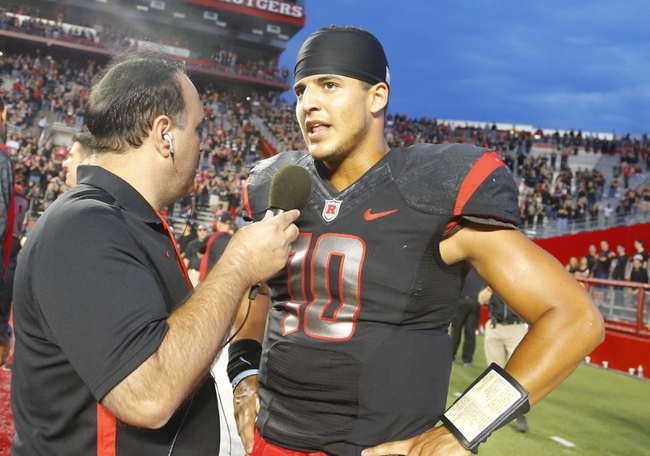 Sep 21, 2013; Piscataway, NJ, USA;  Rutgers Scarlet Knights quarterback Gary Nova (10) interviewed after come from behind victory over Arkansas Razorbacks at High Points Solutions Stadium. Rutgers Scarlet Knights defeat the Arkansas Razorbacks 28-24. Mandatory Credit: Jim O'Connor-USA TODAY Sports