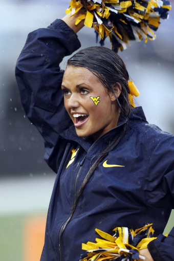 Sep 21, 2013; Baltimore, MD, USA; West Virginia Mountaineers cheerleaders entertained fans during the game against the Maryland Terrapins at M&T Bank Stadium. Mandatory Credit: Mitch Stringer-USA TODAY Sports