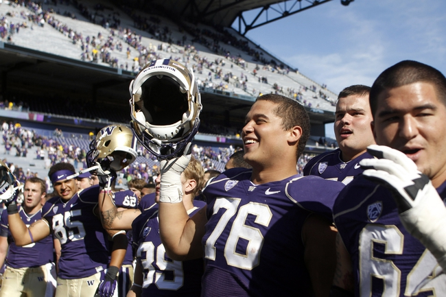 Sep 21, 2013; Seattle, WA, USA; Washington Huskies offensive Lineman Dexter Charles (76) sings the school fight song with his teammates following a 56-0 victory against the Idaho State Bengals at Husky Stadium. Mandatory Credit: Joe Nicholson-USA TODAY Sports
