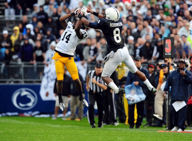 Sep 21, 2013; University Park, PA, USA; Kent State Golden Flashes cornerback Dylan Farrington (14) intercepts a pass intended for Penn State Nittany Lions wide receiver Allen Robinson (8) at Beaver Stadium. Mandatory Credit: Evan Habeeb-USA TODAY Sports