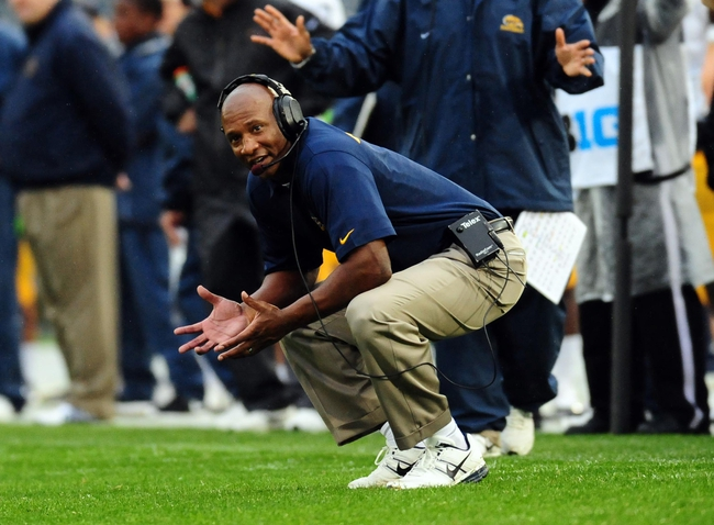 Sep 21, 2013; University Park, PA, USA; Kent State Golden Flashes head coach Paul Haynes (center) looks on during the game against the Penn State Nittany Lions at Beaver Stadium. Mandatory Credit: Evan Habeeb-USA TODAY Sports