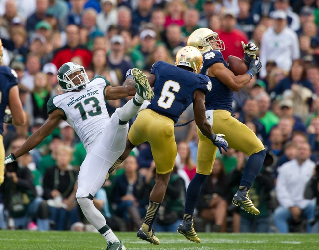 Sep 21, 2013; South Bend, IN, USA; Notre Dame Fighting Irish safety Matthias Farley (41) intercepts a pass intended for Michigan State Spartans wide receiver Bennie Fowler (13) in the third quarter at Notre Dame Stadium. Notre Dame won 17-13. Mandatory Credit: Matt Cashore-USA TODAY Sports