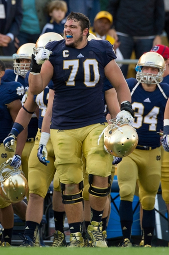 Sep 21, 2013; South Bend, IN, USA; Notre Dame Fighting Irish offensive tackle Zack Martin (70) celebrates on the sideline in the fourth quarter against the Michigan State Spartans at Notre Dame Stadium. Notre Dame won 17-13. Mandatory Credit: Matt Cashore-USA TODAY Sports