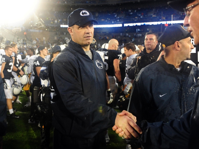 Sep 21, 2013; University Park, PA, USA; Penn State Nittany Lions head coach Bill O'Brien (left) shakes hands with coaches after beating the Kent State Golden Flashes 34-0 at Beaver Stadium. Mandatory Credit: Evan Habeeb-USA TODAY Sports