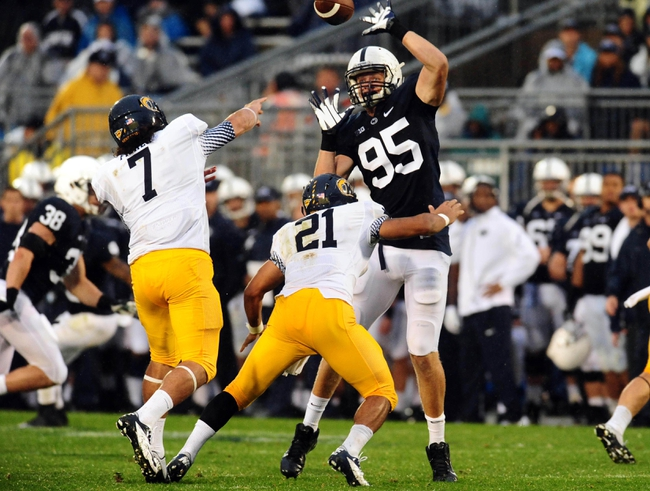 Sep 21, 2013; University Park, PA, USA; Penn State Nittany Lions defensive end Carl Nassib (95) bats down a pass from Kent State Golden Flashes quarterback David Fisher (7) at Beaver Stadium. Mandatory Credit: Evan Habeeb-USA TODAY Sports